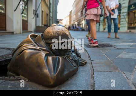 Slovakia, Bratislava, historic center, statue dating from 1997 and titled Cumil by the artist Victor Hulik - Stock Photo
