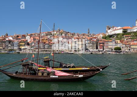 Portugal, North Region, Porto, historical center classified as World Heritage by UNESCO, Cais de Ribeira historic district, Barco Rabelo boat formerly used to transport port wine barrels on the Douro River - Stock Photo