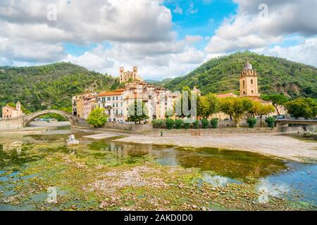 The medieval village of Dolceacqua, Italy, showing the San Fillipo Church, hilltop Castello castle, arched Monet bridge, and the ancient cathedral. - Stock Photo