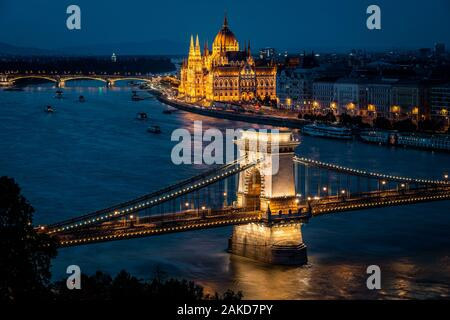 Budapest, Hungary, view of the Hungarian Parliament building and Szechenyi Chain Bridge over the Danube river at dusk.