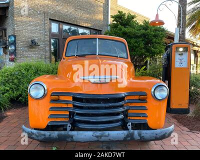 vintage old antique truck at gas station with cobblestone path front view - Stock Photo