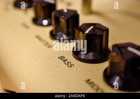 Close up of control knobs on an amp or amplifier for electric and bass guitars - Stock Photo