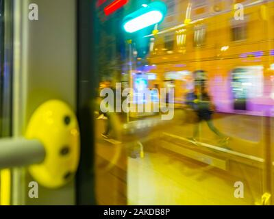 Run running walking for bus passenger view from bus through window city town urban street motion moving driving intentionally blurry blur background - Stock Photo