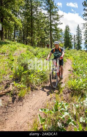 Two middle aged men out riding mountain bikes on Buck Mountain trail outside of Winthrop, Washington, USA. - Stock Photo