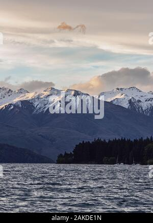 sunset blue hour over tall mountains and Lake Wanaka, New Zealand