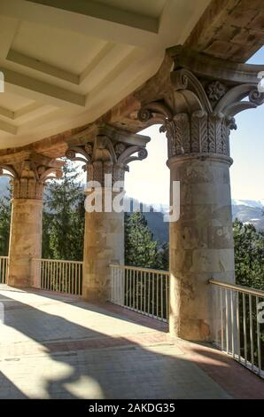 Bearing classical columns framing an oval balcony on the corner of the building of the sanatorium 'Mountain Armenia' in the resort of Dilijan - Stock Photo