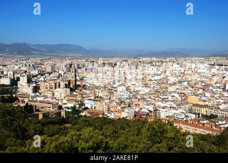 Elevated view of the city with the cathedral in the foreground seen from the castle, Malaga, Malaga Province, Andalucia, Spain. - Stock Photo