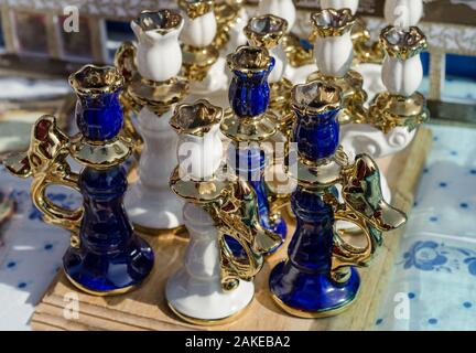 Old alarm clocks and candle holders on flea market in Paris, France - Stock Photo