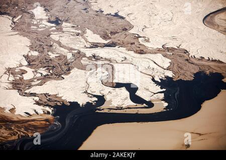Tailings pond at the Syncrude mine north of Fort McMurray, Alberta, Canada. Tailings ponds in the tar sands are unlined and leach toxic chemicals into the surrounding environment.  August 2012 - Stock Photo
