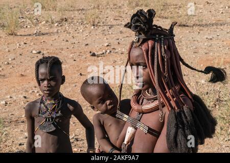 Himba women and children in Kaokoveld, the tribal village Namibia, Africa - Stock Photo