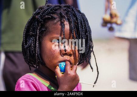 Himba female child in a Himba village, Kaokoveld, Namibia, Africa - Stock Photo