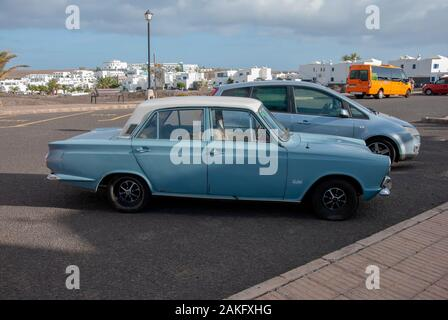 1960's Model Light Blue White Mark One Ford Cortina Motor Car right hand passengers side view of rusty lhd left hand drive four door 4 door ford corti - Stock Photo