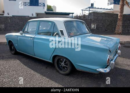 1960's Model Light Blue White Mark One Ford Cortina Motor Car rear left hand drivers side view of rusty lhd left hand drive four door 4 door ford cort - Stock Photo