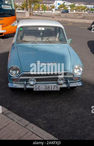 1960's Model Light Blue White Mark One Ford Cortina Motor Car front view of rusty lhd left hand drive four door 4 door ford cortina mk 1 mark I vintag - Stock Photo