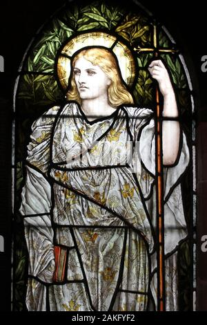 Stained Glass Window depicting Faith - one of the three theological virtues - Stock Photo