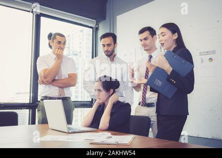 Business group meeting teamwork of unhappy and stress with problem fail, team serious at office with deadline work of employee. - Stock Photo
