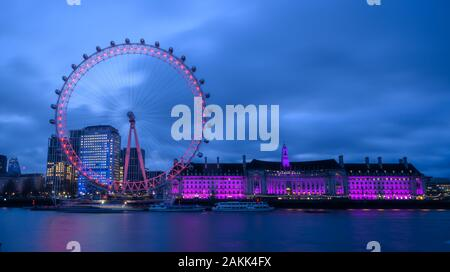 River Thames, London, UK. 9th January 2020. UK Weather: The lights of the  iconic London Eye and County Hall buildings along the South Bank bring brightness to an otherwise dull and gloomy morning in central London. Credit: Celia McMahon/Alamy Live News. - Stock Photo