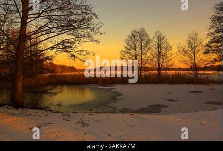 This beautiful sunset mood was photographed at the Kellersee in Malente. - Stock Photo