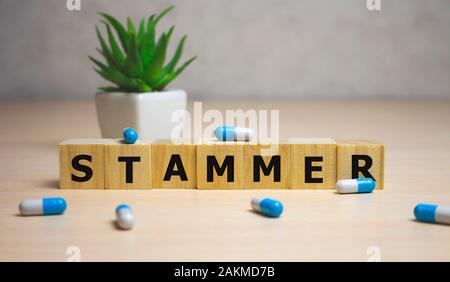 Stammer word made with building blocks. medical concept. - Stock Photo