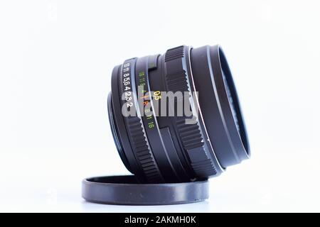 Old Russian Zenith vintage 58mm fixed lens isolated with white background, focus on aperture ring. - Stock Photo