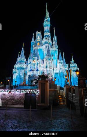 General view of Cinderella's Castle at night, in the Magic Kingdom during Christmastime in Orlando, Florida. - Stock Photo