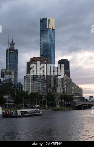 MELBOURNE, AUSTRALIA - 10 March 2019: The Eureka Tower and half built Australia 108 tower along the Yarra River - Stock Photo