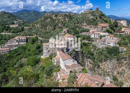 Savoca village on Sicily Island in Italy - view with ruins of Pentefur castle on a hill and Chiesa Madre di Savoca church on foreground - Stock Photo