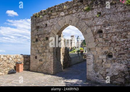 Church of San Nicolo also known as Church of San Lucia in Savoca village seen through 12th century gate of medieval city walls, Sicily in Italy - Stock Photo