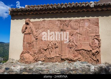 Relief next to Church of San Nicolo also known as Church of San Lucia in Savoca village seen through 12th century gate of medieval city walls, Sicily - Stock Photo