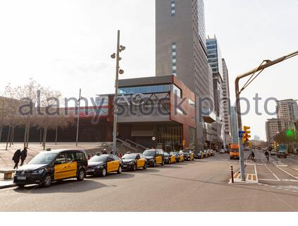 Black and yellow taxis waiting to be hired in Barcelona. Diagonal Mar area (International Barcelona Convention Center) - Stock Photo