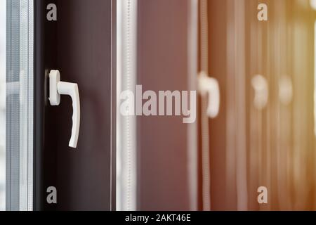 Windows row in office building. Modern windows with handles. Rows of windows in new apartment. - Stock Photo