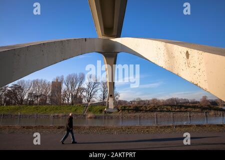pedestrian under the bridge in the Rhine harbor in the district Muelheim, Cologne, Germany.  Fussgaenger unter der Katzenbuckelbruecke im Muelheimer H - Stock Photo