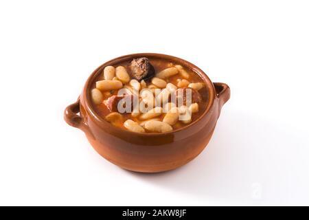 Typical Spanish fabada asturiana isolated on white background - Stock Photo