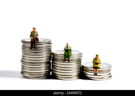 Miniature figurine pensioners,sitting on 10 pence piece coins - Stock Photo