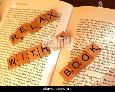 Relax with a book, promotion of reading and physical books - Stock Photo