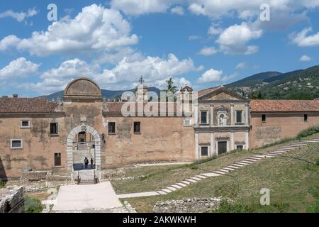 entrance of ancient Baroque San Lorenzo Certosa, shot in bright summer sun light at Padula, Salerno, Campania, Italy - Stock Photo