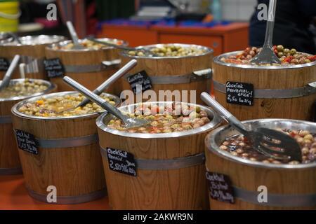 Many varieties of olives on sale at Les Halles de Pau, indoor market, Pau, Pyrenees Atlantiques, Nouvelle Aquitaine, France - Stock Photo