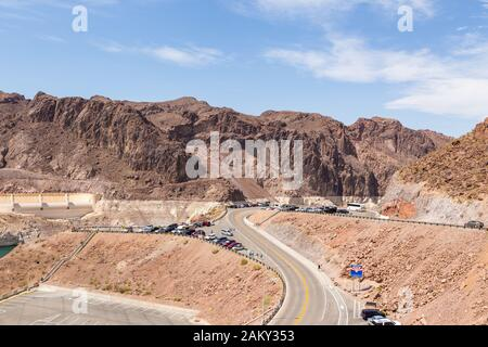 Boulder City, Nevada, USA- 01 June 2015: View of the Hoover Dam, a concrete gravitational arc dam, built in the Black Canyon on the Colorado River. Ro - Stock Photo