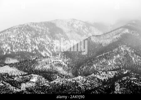 Black & white of cloudy winter view of snow covered Methodist Mountain; Sangre de Cristo Range; near Salida; Coloraod; USA - Stock Photo