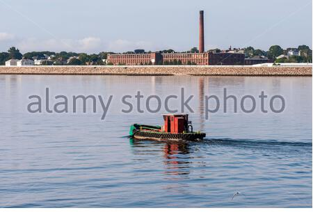 New Bedford, Massachusetts, USA - July 26, 2019: Water tender Chippy crossing New Bedford outer harbor - Stock Photo