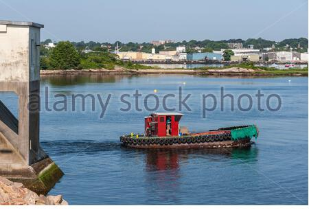 New Bedford, Massachusetts, USA - July 26, 2019: Water tender Chippy crossing New Bedford inner harbor after transiting dike - Stock Photo