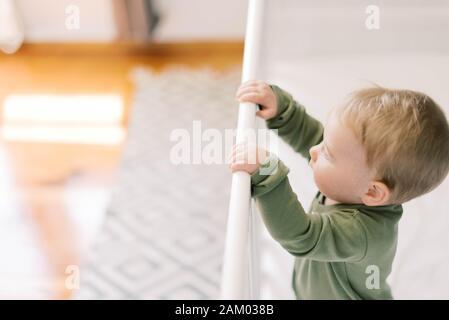Little baby girl in her nursery.