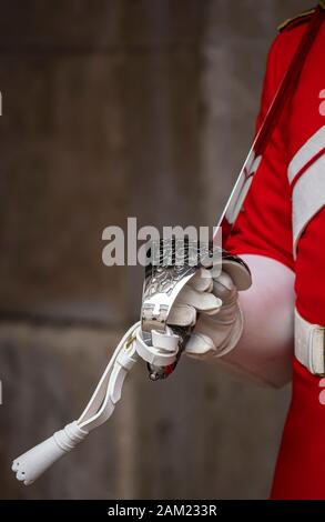 WESTMINSTER, LONDON: Close Up of a Life Guard of the Household Cavalry holding a sword - Stock Photo