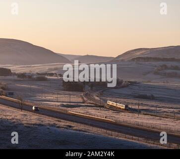 First Transpennine Express class 350 siemens desiro train passing Tebay on the west coast mainline in Cumbria with a Manchester to Glasgow train - Stock Photo