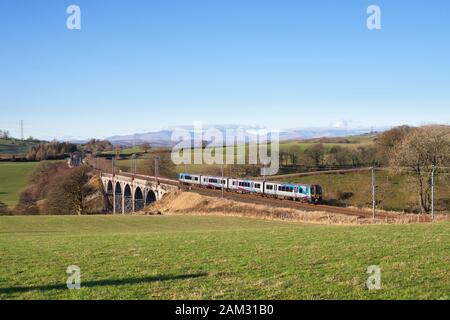 First Transpennine Express class 350 siemens desiro train passing Docker on the west coast mainline in Cumbria with a Manchester to Glasgow train - Stock Photo