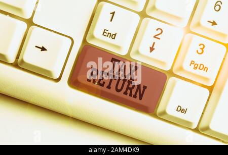 Word writing text Tax Return. Business photo showcasing Tax payer financial information Tax Liability and Payment report White pc keyboard with empty - Stock Photo