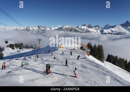 Oberstdorf, Germany. 11th Jan, 2020. Winter sports enthusiasts ride on the Fellhorn above the clouds in the sunshine. Credit: Karl-Josef Hildenbrand/dpa/Alamy Live News - Stock Photo