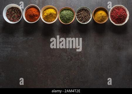 Set of variety aromatic spices and herbs in bowls - Stock Photo