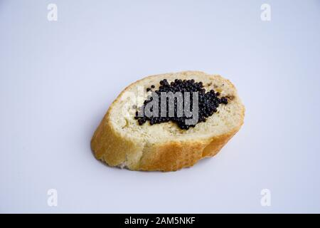 one sandwich with black caviar isolated on the white background - Stock Photo
