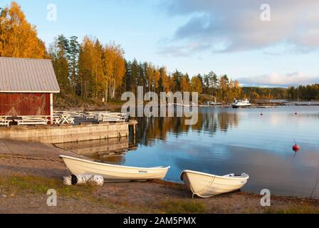 Puumala, Finland–October 5, 2019: Boats on the waterside of Saimaa Lake on the territory of Sahanlahti Resort. Puumala Municipality. Southern Savonia - Stock Photo